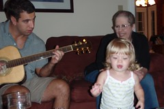 Cate dancing while my brother plays guitar
