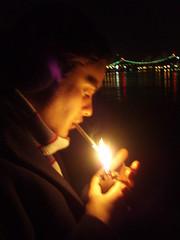 On a Ledge by the East River (ommelebommelestien) Tags: newyorkcity cigarette eastriver zippolighter