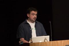 Me, on stage at MerbCamp talking about Django