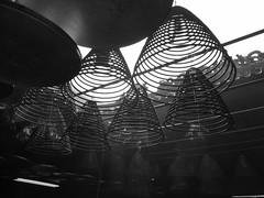 hanging incense (* andrew) Tags: blackandwhite bw temple hongkong blackwhite smoke 28mm hanging stick coil grdigital ricoh incense yaumatei templestreet tinhautemple grd burningstick file:name=20081018grd008jpg