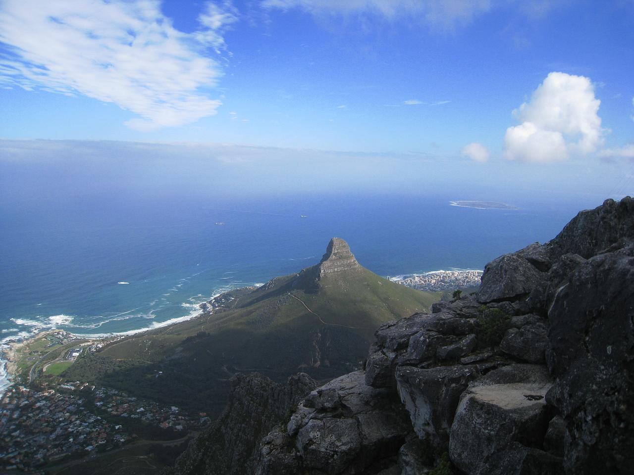 Looking down on Lion's Head from atop the taller Table Mountain