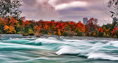 Ride the Rapids Sunset Mist (JamesWatkins) Tags: autumn autumnfoliage vacation ny newyork canada art fall water leaves landscapes flora rocks poetry fallcolors niagrafalls niagra falls autumnleaves rapids autumncolors fallfoliage foliage fantasy waterfalls rivers newyorkstate streams poems poets fallscenes nystate dreamscapes beautifulscenery d300 ps3 beautifulwater rocksandwater movingwater creativewriting riversandstreams flowingwater canadianfalls freeverse beautifulleaves darkcolors niagrafallson niagrafallsny nikkor18200vr niagrafallscanada autumninnewyork fastwater jameswatkins poetryandpicturesinternational beautifulwaterfalls autumnscenes colorfulscenery beautifulscenes goldstaraward fastmovingwater flickrlovers goldenheartaward lesamisdupetitprince swiftstreams beautifulfallscenery ridingtherapids extremerapids newyorkdestinations