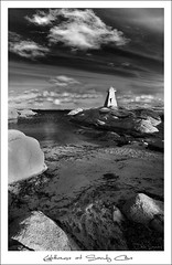 Lighthouse at Sandy Cove (Dave the Haligonian) Tags: ocean sea sky bw lighthouse canada beach water clouds blackwhite interestingness nikon rocks novascotia atlantic explore d200 sandycove sigma1020mm terencebay martime supershot magicdonkey prospectbay anawesomeshot niksoftware adobephotoshopcs3 theperfectphotographer silverefexpro lighthouseatsandycove nkn8714 dontletboobsgetinthewayofyourpoledancing