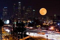 Moonrise over the LA skyline (Eric Wolfe) Tags: california city usa moon skyline night buildings landscape la losangeles downtown cityscape nightscape unitedstates metro towers fullmoon moonrise freeway astronomy skyscapers original:filename=200812120302jpg