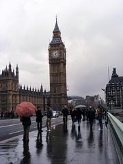 Westminster Bridge in the rain (chas + jo) Tags: bridge red reflection london tower clock wet westminster rain umbrella housesofparliament bigben wetraveltheworld