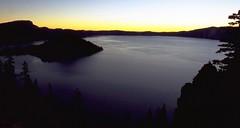 Crater Lake Sunrise Sequence #1 (wanderingYew2) Tags: film oregon forest sunrise landscape island dawn volcano nationalpark crater caldera pacificnorthwest pacificcresttrail wizardisland filmscan hikingtrail cascaderange craterlakenationalpark volcaniclake mountmazama allamericanroad nationalscenictrail americashikingtriplecrown