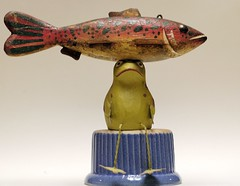Fish on a Frog (ricko) Tags: fish deleteme10 bowl frog toyfrog antiquefish