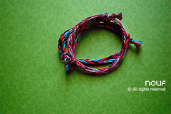(*glow) Tags: green glow handmade craft bracelets 20 knots wristband handcraft braid qatar purples friendshipbracelet nouf