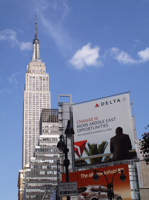 the Empire State Building and a nearby billboard, Manhattan, NYC