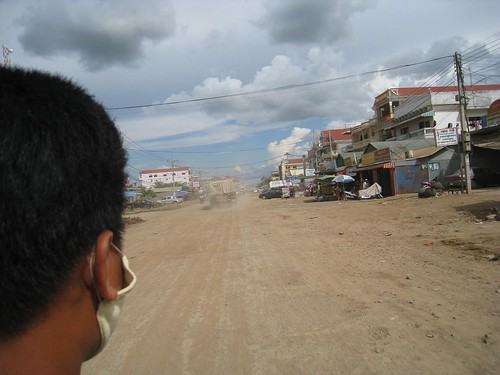 An unexpected motorbike ride, just for me, to catch up with the first bus leaving for Siem Reap