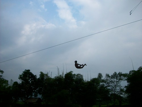 Local doing a salto on the swing