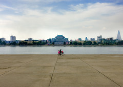 Not a very busy day in Pyongyang (Eric Lafforgue) Tags: pictures travel bike canon photo war couple asia ride picture korea kimjongil asie coree velo journalist journalists northkorea pyongyang  dprk  coreadelnorte juche 1536 kimilsung nordkorea lafforgue  taedong  ericlafforgue   coredunord coreadelnord  northcorea coreedunord rdpc  insidenorthkorea  rpdc   demokratischevolksrepublik coriadonorte  kimjongun coreiadonorte