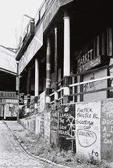 Dunbars Signage (scottchiz) Tags: leica shop 50mm graffiti glasgow flag thistle trix 14 400 signage pillars summilux m6 partick bartons standrewsmarket minibarras