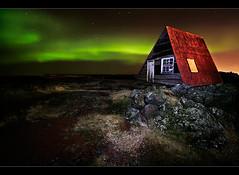 Red Roofed Hut II (orvaratli) Tags: travel red sky house stone night landscape iceland arctic hut aurora rood starts auroraborealis borealis icelandic solarstorm magneticstorm arcticphoto lpdwellings rvaratli orvaratli