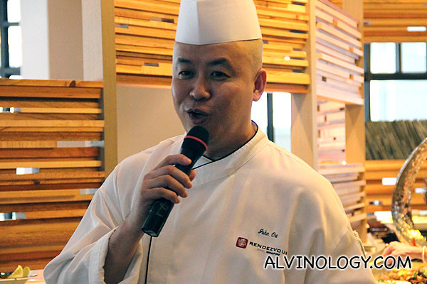 Straits Cafe head chef greeting everyone
