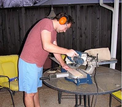 Kenny cutting a board