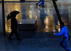 Street Scene, Barcelona (BarcelonaPhotographyCourses) Tags: barcelona street colour wet rain weather reflections running damp wwwbarcelonaphotographycoursescom