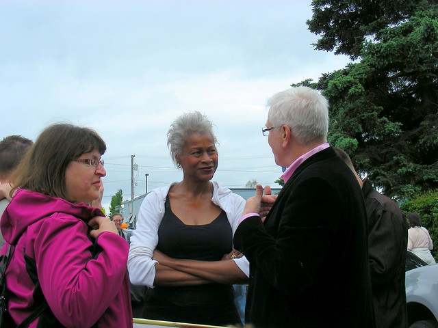 Harriet Drummond & Elvi Gray-Jackson talking with Pride parade Grand Marshal Doug Frank