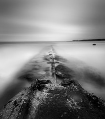 That Sinking Feeling (Corica) Tags: uk longexposure greatbritain sea england coast rocks britain yorkshire northsea whitby northyorkshire sandsend sigma1020mm corica canon400d pixelda