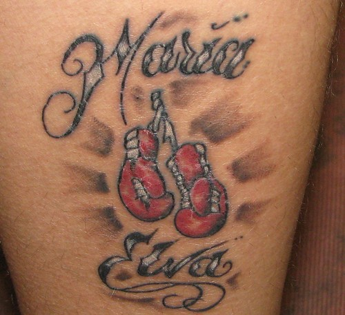 Some of the boxing tattoos you might consider could be of your favorite