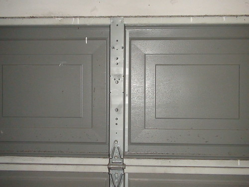 I Have This Old Ceco/Windsor Garage Door. The Top Center Bracket Rip/tore  From The Door Because Of Repeated Use Of A Garage Door Opener. Anyway To  Fix This?