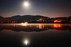 Lago at Night (Michele Catania) Tags: summer italy lake holiday reflection beach nature water festival night canon reflections river lago europe italia waves open estate riflessi treviso revine canon1855mmf3556 golddragon abigfave canoneos400d anawesomeshot theunforgettablepictures theperfectphotographer lagodirevine michelecatania lagofilmfest revineallago