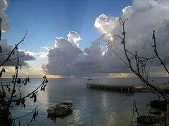 Evening Time (Winsome J M) Tags: ocean sunset sea sky nature water clouds pier boat dock searchthebest caribbean caymanislands westindies anawesomeshot ultimateshot windydear canonpowershotsd870is whitehallbay