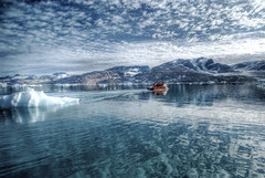 Reflections on the Arctic Sea (wili_hybrid) Tags: trip travel summer vacation sky holiday snow cold ice nature water clouds reflections landscape geotagged fun outside outdoors boat photo yahoo high cool nikon europe flickr european day tour exterior dynamic cloudy photos outdoor topv1111 north picture floating august pic arctic journey greenland boating wikipedia chilly imaging nordic iceberg d200 rts scandinavia northern mapping range geotag chill tone scandinavian hdri photomatix flickrland nikond200 arcticsea tonemapped tonemapping tasiilaq highdynamicrangeimaging randomtravelerssociety catchycolorsflickrish fl0509