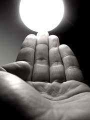 ouch! hot! (Maʝicdölphin) Tags: bw hot macro lightbulb canon ouch hand fingers powershot a590