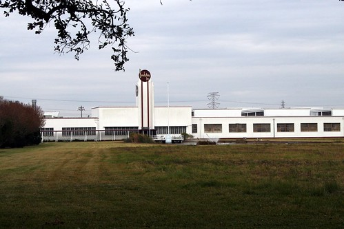 view of brochsteins, inc. through chain link fence