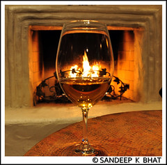 Wine On Fire (Sandeep K Bhat) Tags: glass table fire fireplace wine dragonfly napa inspire mondavi doubledragon contestwinner flickrstars diamondheart platinumphoto aplusphoto flickraward quarzoespecial photographersgonewild