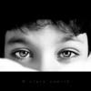 I'd bury my dreams underground (Clara Zamith) Tags: light bw white black eye monochrome smile contrast canon rebel kid child brother expression pb pillow hidden hide photograph xti 400d clarazamith