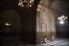 two men in Badshahi Mosque - Lahore (Maciej Dakowicz) Tags: travel pakistan tourism architecture asia muslim islam faith prayer religion mosque punjab lahore badshahi