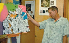 Burns High School art teacher Eric Ersch takes a look at a piece of art by junior Sara Diaz. (Photo by LAUREN BROWN)