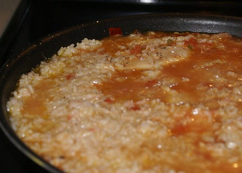 add rice, cover, simmer--this belongs three pictures ago. figure it out.