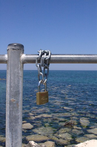 Padlock by the sea