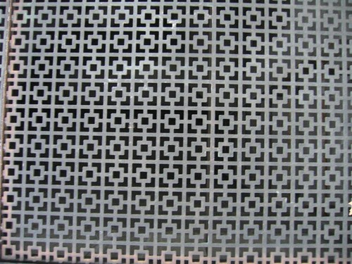 Metal grate over a vent shaft