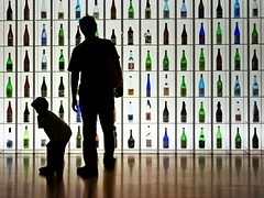 A little too early for you, kid. (tanakawho) Tags: city blue boy people urban man color reflection green geometric glass silhouette vertical horizontal tokyo bottle colorful display father son line shelf sake tanakawho theunforgettablepictures masterpiecesoflightanddark karmanominated afterclass290