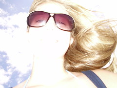 Blast (kkelly2007) Tags: light portrait sky woman girl sunglasses lady clouds self mouth hair nose eyes purple bright wind blowing