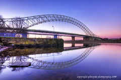 reflections all the way to widnes (gobayode photography...times) Tags: bridge cheshire thebridge bridgethegap northengland runcornbridge curvedbridge widnesbridge runcorncheshire runcornwidnessbridge widnescheshire runcorntowidnes aboveandunder bridgingneighbours widnesandruncorngapfilled