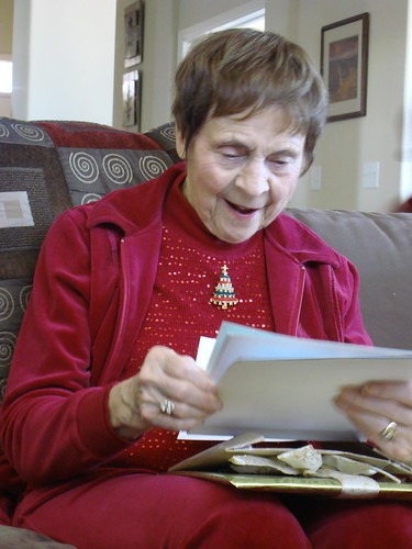 Grandma Looks at her New Scrapbook Pages