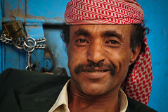 High on chat - Taizz Yemen (Znapshot.) Tags: travel boy portrait people man guy boys bike closeup catchycolors nikon perfect chat gesicht pretty photographer market portait awesome hijab arabic adventure cover arab valley yemen sanaa nikkor fabulous markt lachen oldcity biketour becher aden qat arabisch d300 laecheln quat cloeup goldenglobe blackskin altestadt jemen flickrsbest totalphoto passionphotography taizz thecolor anawesomeshot colorphotoaward aplusphoto ultimateshot arabik nikond300 wadidawan adventu memorycornerportraits marcobecher michaelatischer wwwmarcobecherde photographybyznapshot