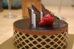 Chocolate birthday cake from Finale (Chris Devers) Tags: food cake ma dessert chocolate massachusetts somerville finale somervillema 2009 cameranikond50 exif:exposure_bias=0ev exif:focal_length=55mm exif:exposure=0017sec160 exif:aperture=f48 camera:make=nikoncorporation exif:flash=autofiredreturndetected camera:model=nikond50 meta:exif=1257942050 exif:orientation=horizontalnormal exif:lens=18200mmf3556 exif:filename=dscjpg exif:vari_program=auto exif:shutter_count=27982 meta:exif=1350403256