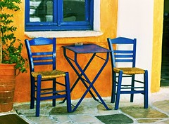 Chairs and table (Marite2007) Tags: blue windows orange house yellow architecture facade table outside island greek wooden cafe intense exterior chairs terrace outdoor vibrant traditional picture hellas vivid lifestyle scene icon location greece seats destination recreation colourful typical cheerful picturesque iconic catchy paros cyclades cafes otw kartpostal kafeneio theunforgettablepictures islandslefkes