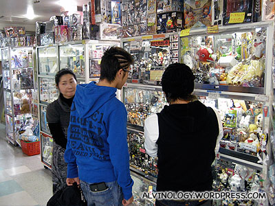 Japanese teens checking out plastic figurines