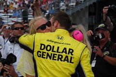 Ed Carpenter greeted by wife Heather Carpenter (IndyCar Series) Tags: camera speed nikon racing length mode rating oval ims indy500 indycar dollargeneral izod indianapolis500 2011 indianapolismotorspeedway 751 edcarpenter sarahfisherracing 5focal 200metering 31251000000fnumber d2xexposure 6710iso