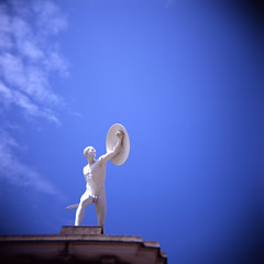 Statue at the gates of Schloss Charlottenburg (atomicjeep) Tags: sky holiday berlin film statue germany holga fighter think toycamera plastic velvia dont creativecommons sword shield 50 schloss vignette charlottenburg schlosscharlottenburg bsquare i