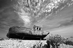 Last resting place (woolyboy) Tags: uk sky beach clouds boat kent fishing bravo view wide shingle sigma dungeness 1020mm clinker woolyboy damniwishidtakenthat