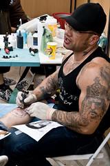 Tattoo Art Fest (161/290) - 04-06Jul08, Paris (France) (°]°) Tags: show portrait man paris art festival tattoo ink glasses muscle bodybuilding convention glove cape casquette bodybuilder bodyart 2008 lunettes homme encre tatouage parcfloral gant tattooartfest