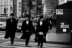 Jewish trio crossing street @ New York City, USA (Doudou) Tags: street nyc newyorkcity trip travel urban bw usa white ny newyork black building apple america canon big noir crossing pavement manhattan nb sidewalk american zebra jewish trio blanc juif 400d